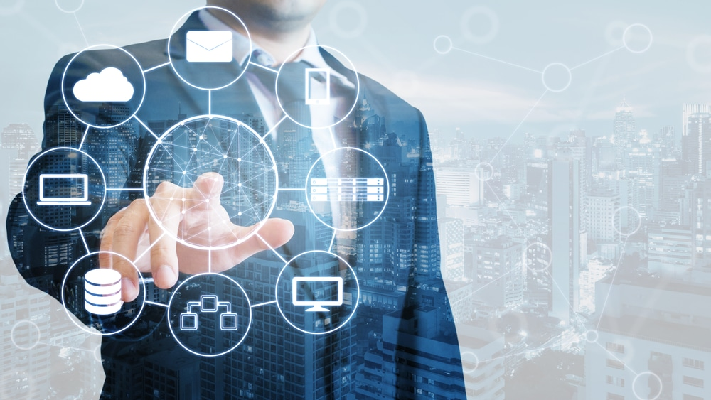 Double exposure of professional businessman connected devices world digital technology internet and wireless network on touch screen and city of business background, business and technology concept