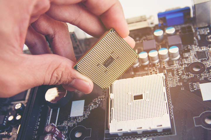 desktop processor being installed on a motherboard